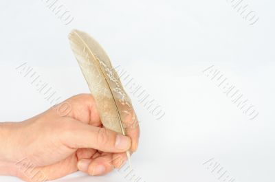 Writing with a piece of feather