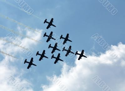 Aerobatic group on the background of white clouds