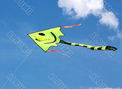 Flying kite in the blue sky