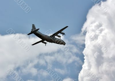 Russian transport airplane in the summer sky