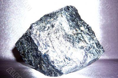 Beautiful shiny stone on a gray background.