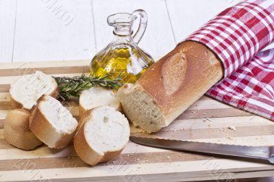 sliced baguette bread and oil