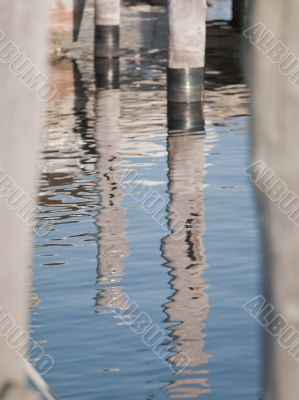 rippled water reflection of dock