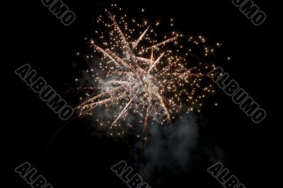 fireworks explode into a ball of sparks