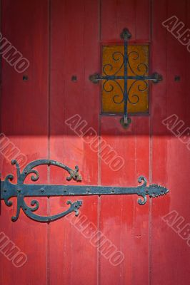 red door with intricate by hinge