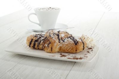 chocolate flavor croissant with coffee on the side