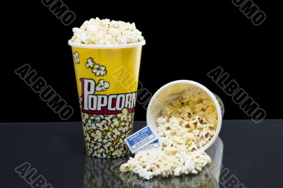 two bucket of popcorn with tickets