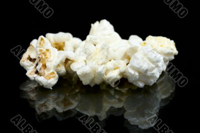 pieces of popcorn on the table