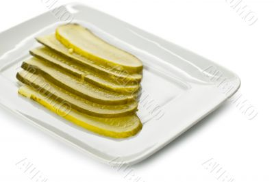slices of fresh pickles on the plate