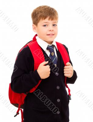 School boy standing with his backpack.