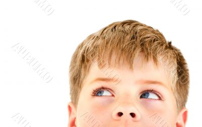 Blond boy looking into the corner. Isolated on white.