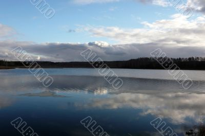 Lake with reflection of the sky in the water.