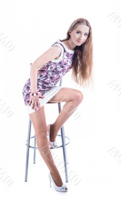 blonde girl on high stool