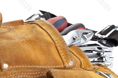 spanners in brown tool belt