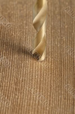 macro shot of drilling a hole in wood