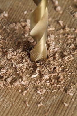 bit drilling through wood