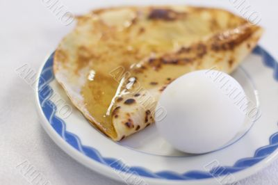 Boiled eggs and pancake