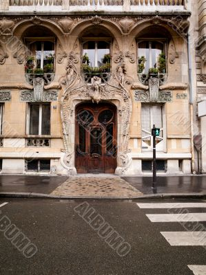 an elaborate door and stone carved building