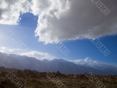 cloudy sky and rough terrain