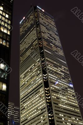 low angle shot of illuminated office building at night