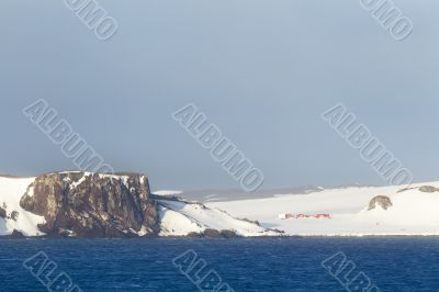 snowy cliff and sea