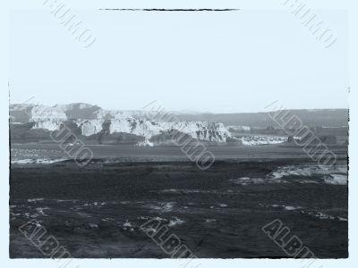 black and white image of mountain range
