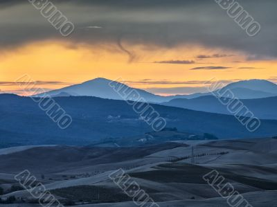 scenic sunset shot with valley and mountain range