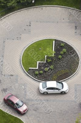 cars in a circular driveway