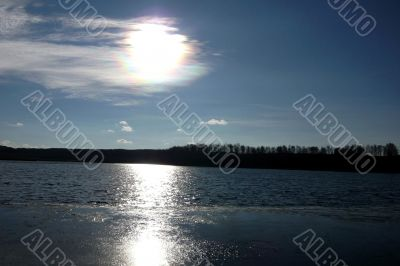 Lake and sky with sun.