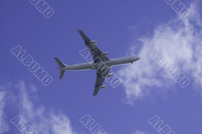 Commercial Airplane in blue sky