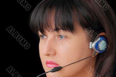 Woman in earphone with blue eyes