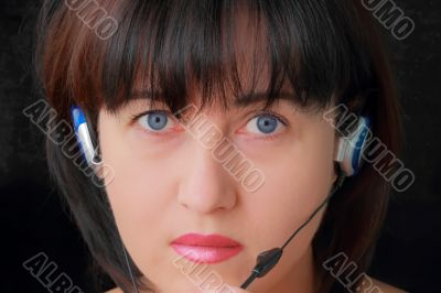 Woman in earphone with blue eyes