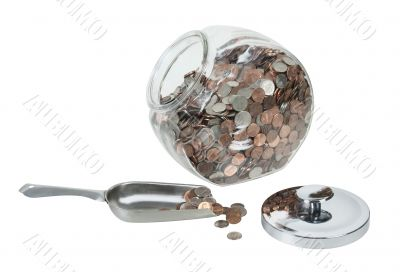 Glass Jar Full of Coins with a Metal Scoop