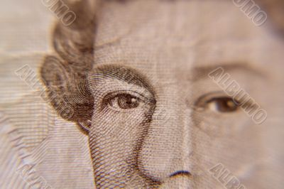 Closeup of Queen Elizabeth, on a british five pound note