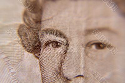 Closeup of Queen Elizabeth, on a british five pound note