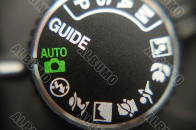 Macro image of a digital camera`s controls set on auto