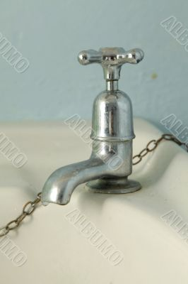 Old silver faucet
