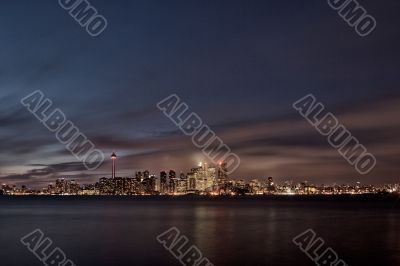 view of cityscape and sea at night toronto ontario canada