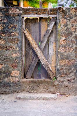 Wood Door Embedded in Stone