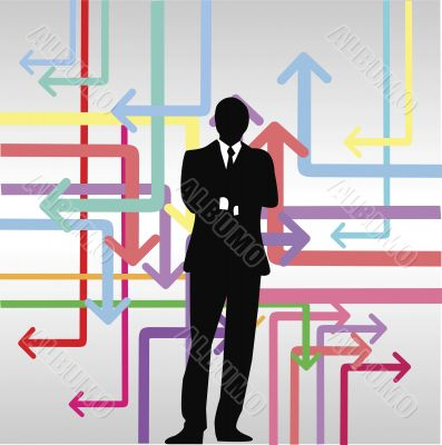 businessman standing in front of colorful arrow signs