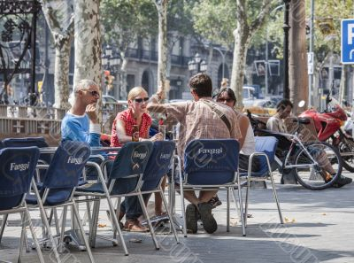 men and women at outdoors restaurant in barcelona spain