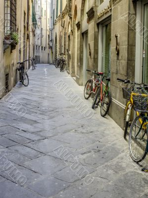 bicycles parked on the street in tuscany
