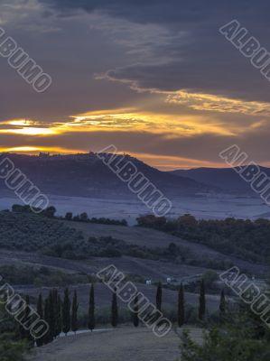 rollingtuscan landscape at dusk