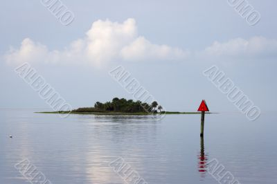 An island mostly flooded during a higher tide