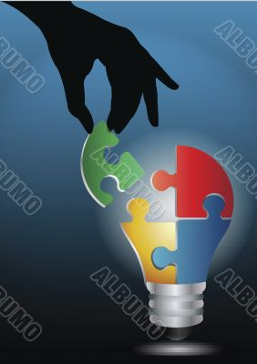 human hand joining light bulb puzzle