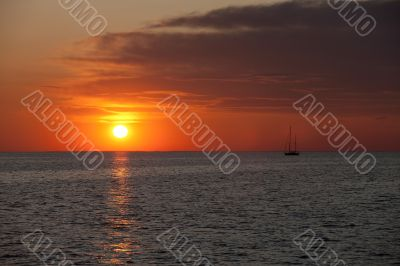 image of watercraft in sea at sunset