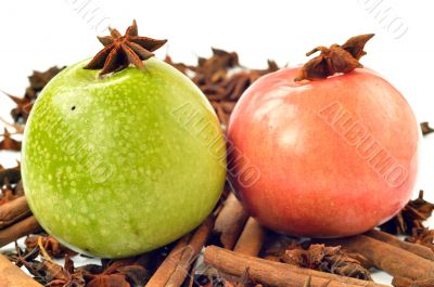 Green and pink apple with spices