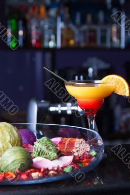 Orange cocktail with a straw
