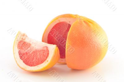 Fresh red grapefruit on white background