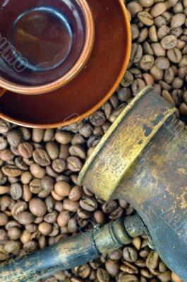 Coffee pot, cup and coffee beans close-up